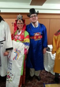Trying on Korean wedding attire at orientation