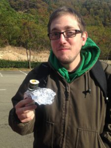 Nick at the start of the field trip. He's eating a kimbap roll!
