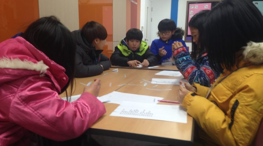 Here are more students working on a word riddle game.